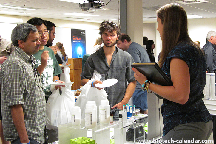 Happy scientists learn about new lab supplies that are available to them.