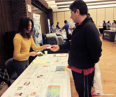 A researcher from the 2015 BioResearch Product Faire™ event in Chicago learns about new products available for his lab.