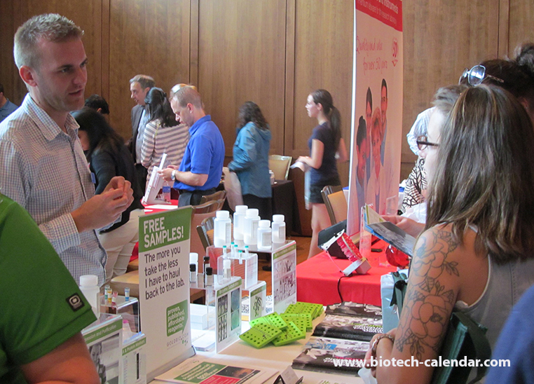 A lab supplier discuses his lab products with active life science researchers at the 2014 BioResearch Product Faire™ Event in Madison.