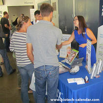 A sales rep discuss new products with life scientists at a past BioResearch Product Faire™ Event in Irvine.