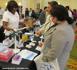 Researchers in Houston discuss new lab equipment with a science supply company sales rep.