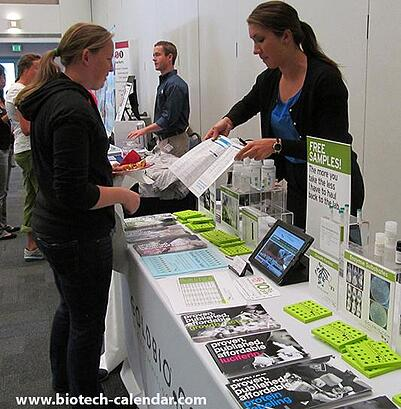 UCSB researcher looks at new lab product supplies at life science vendor show.