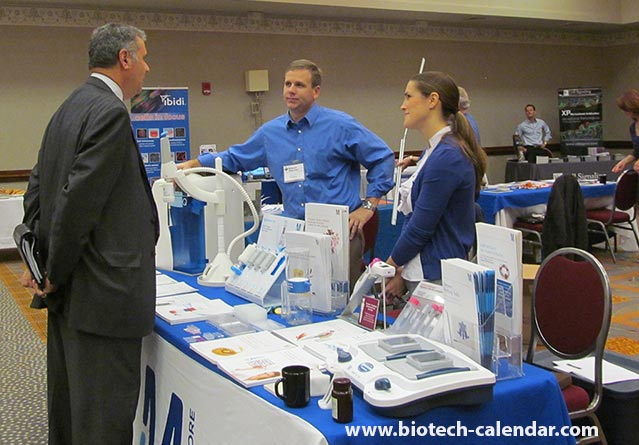 Researchers and lab suppliers discuss products at a past BioResearch Product Faire™ Event.