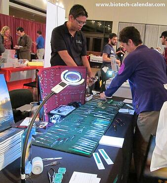 A TAMU researcher finds new products at the 2014 biotech event.