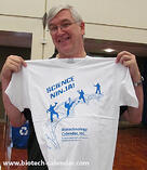 A happy researcher shows off his new Science Ninja shirt from a BCI event.