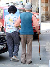 An elderly couple out for a walk.