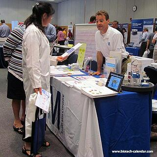 Researchers visiting a booth at the UM, Ann Arbor event
