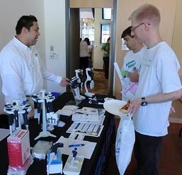 Researchers discuss the benefits of new products with a lab supplier at a past BioResearch Product Faire™ Event.