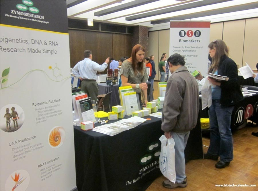 A lab supplier discusses lab supplies with interested researchers at a past BioResearch Product Faire™ Event.