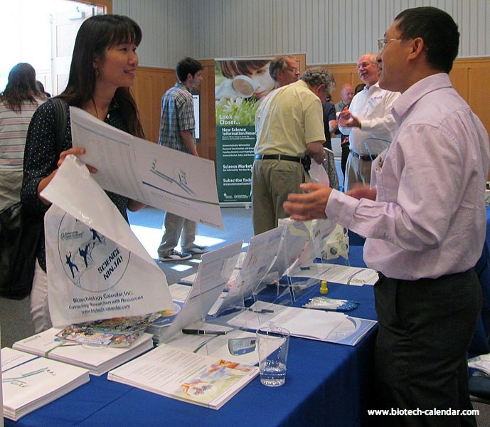 A researcher discuss new products at a past BioReserach Product Faire ™ Event in Ann Arbor, MI.