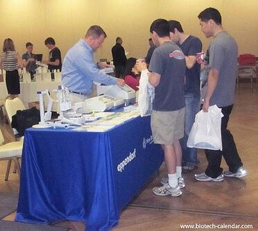 A lab supplier discusses products with active life science researchers at the 2014 event.