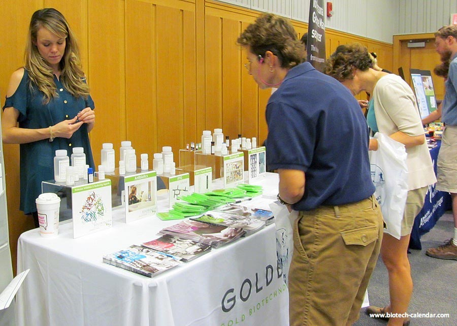 A lab supplier displays products to interested researchers at a past Biotechnology Calendar, Inc. event in Michigan.