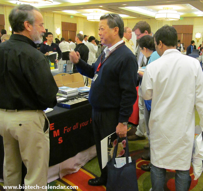 Electron Microscopy Sciences exhibitor discuss the latest labware with intrigued researcher.
