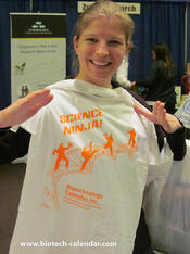 One researcher shows off her new Science Ninja tee at a UCSF Biotechnology Vendor Showcase™ Event.