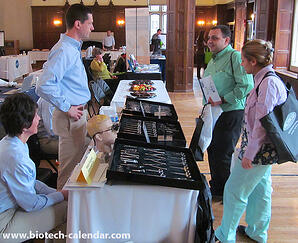 Georgetown event exhibitors demonstrate their laboratory products to university scientists.