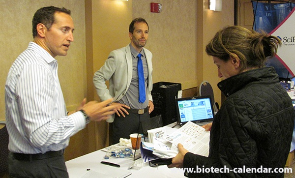 Laboratory equipment suppliers demonstrate their products to Harvard life science researchers.
