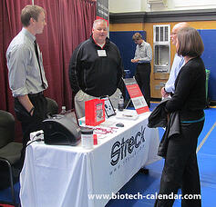 Researchers discuss new products with vendors at a past Biotechnology Vendor Showcase™ Event in San Francisco.