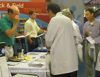 Researchers discussing laboratory products at last year's trade fair event