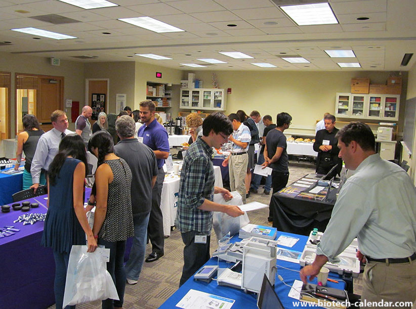 Researchers viewing new lab products at last year's trade fair