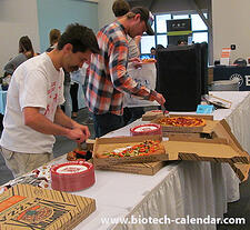 Researchers enjoy complimentary pizza at a past BioResearch Product Faire™ Event.