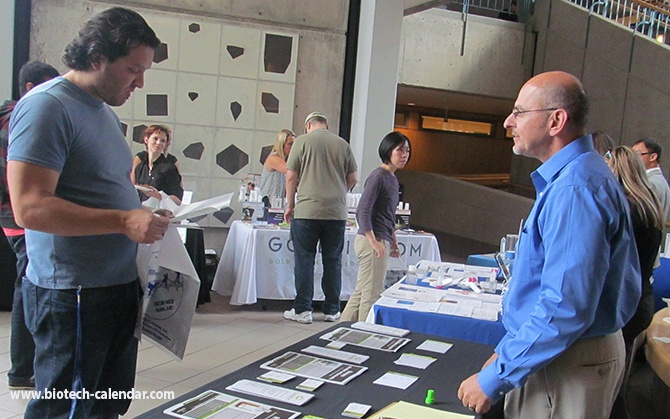 Researchers at last year's event discussing new lab equipment with specialists