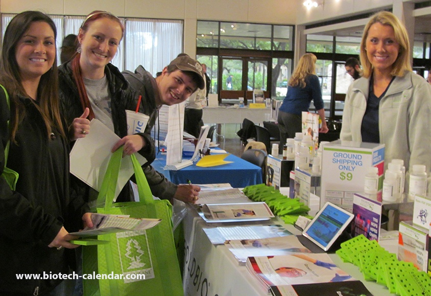 Researchers meeting with a lab product specialist at last year's trade fair