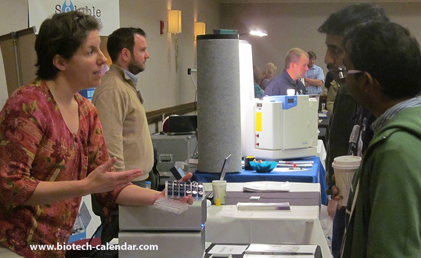 Researchers at our 2015 trade fair discussing new lab products with company specialists
