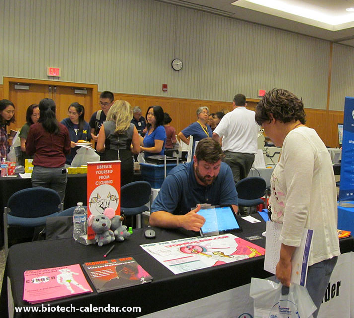 A lab product specialist demonstrating new equipment to a UM researcher at last year's event