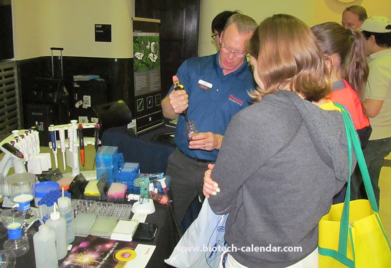 A lab product specialist demonstrating equipment at last year's trade fair