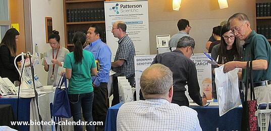 Researchers discussing latest lab products with specialists at our last USC event