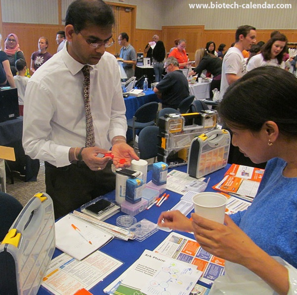 Life science vendors show products to scientists at the BioResearch Product Faire™ event in Ann Arbor, Michigan